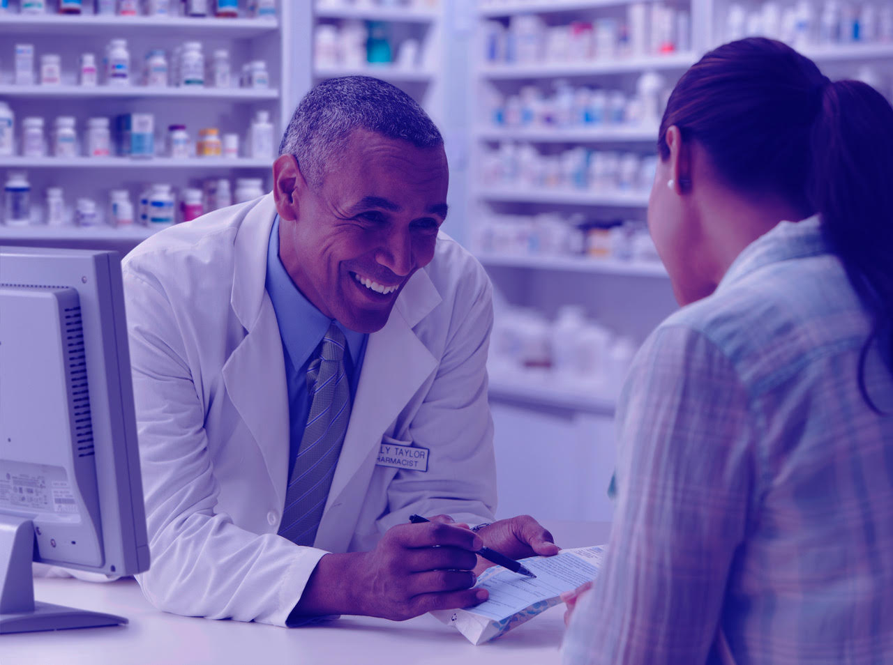 pharmacist talking with client